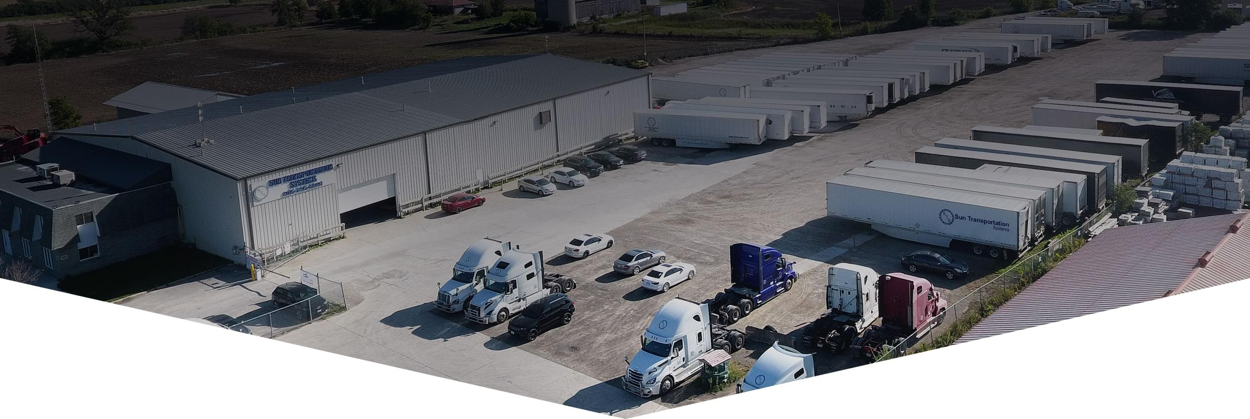 An aerial view of STS property, with building, vehicles, trucks, trailers and equipment available to lease.